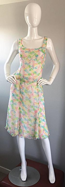 Chic vintage RENA LANGE silk chiffon skirt and blouse set! Features colorful dragonflies printed throughout. Beautiful colors of pink, green, blue and yellow. Lace edges at bust and sleeves. Double layered silk chiffon. Flirty skirt literally flows