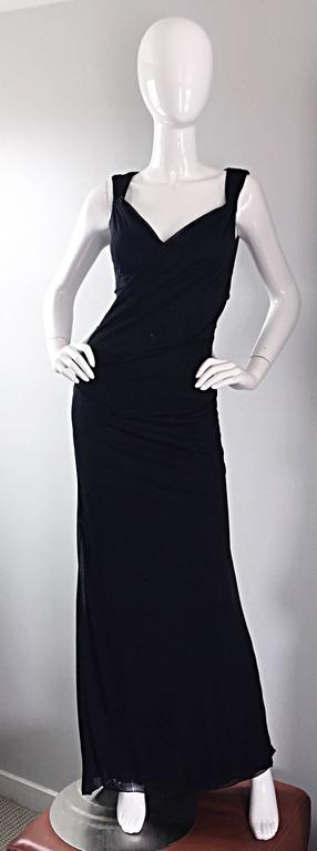 Sexy 1990s / 90s vintage RICHARD TYLER COUTURE black jersey evening gown, with flattering cut - out back. Hand-sewn black glass beads at shoulders. Ruching at front bodice is very slimming, and reveals just the right amount of cleavage. Exudes a
