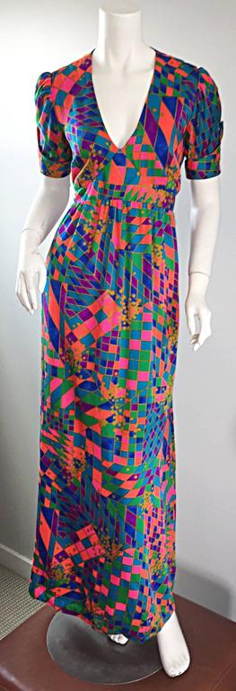 AMAZING and super rare vintage 70s DEAR dress! I have only had the privilege of owning one dress from this label before. I was super excited about that dress, BUT this dress takes the cake! Quite possibly my favorite 70s boho dress EVER! Vibrant