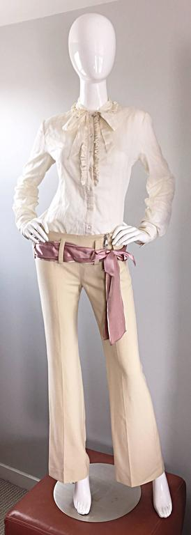 Brand new with tags ALEXANDER MCQUEEN ivory lightweight cotton long sleeve button down shirt with tied pussycat bow at neck! Ruffles down the bodice resemble a man's tuxedo shirt. Hand crochet slight cut-out vertical stripes.throughout. Has a slight