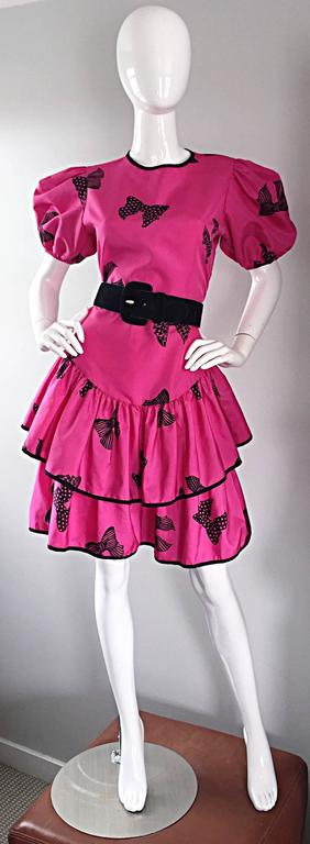 Incredible vintage 1980s BETSEY JOHNSON ' Punk Label ' shocking hot pink and black printed bow dress! There is so much detail to this gem! Tiered cupcake skirt, with a fitted bodice and full pouf sleeves. Black trimmed hems and collar, with elastic