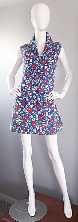 Rare and super adorable vintage 60s ABERCROMBIE & FITCH cotton romper / onesie / jumpsuit with attached skort! Buttons up the bodice. Cute red, white and blue printed flowers throughout. Looks so chic on! Great with sandals, flats, wedges or heels.
