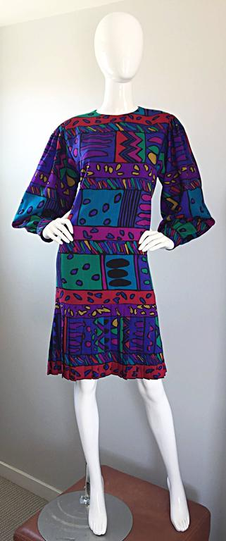 Such a fun HELGA HOWIE colorful op-art dress! Soft cotton with vibrant hues of purple, blue, pink, fuchsia, green, red, yellow and orange! Hearts in various shapes and sizes printed throughout. Flattering drop waist, with knife pleats at the hem of
