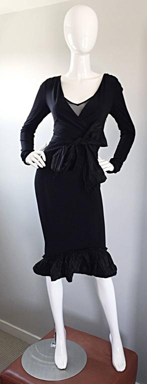 Super flattering vintage 90s VERA WANG black jersey wrap dress! So much detail on this little black dress! Stretch to fit silk rayon jersey with a net underlay at bust that reveals just the right amount of cleavage. Silk taffeta flared hem with