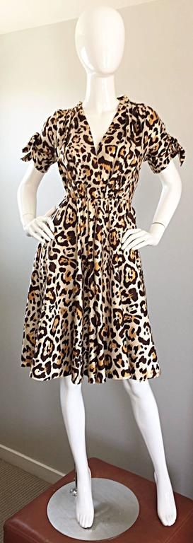 Beautiful JOHN GALLIANO for CHRISTIAN DIOR leopard print 40s style silk dress! Classic animal print on a luxurious silk that flows with the body like fluid!Chic ties at each exterior arm cuff. Flirty skirt with a nipped bodice that flatters the