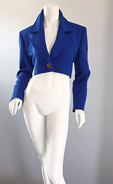 Amazing vintage YVES SAINT LAURENT ( YSL ) Rive Gauche cropped electric blue bolero blazer! Features an oversize gold button at waist and at each sleeve cuff (spare buttons are sewn to the interior). Chic slim fit that looks wonderful on! Fully