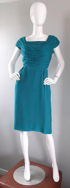 Beautiful 1950s ELLIETTE LEWIS teal blue silk chiffon dress! Pleated ruched bodice has a Grecian feel, and features cap sleeves. Flattering straight skirt. Multiple layers of soft silk chiffon. Full metal zipper with hook-and-eye closure. Vibrant