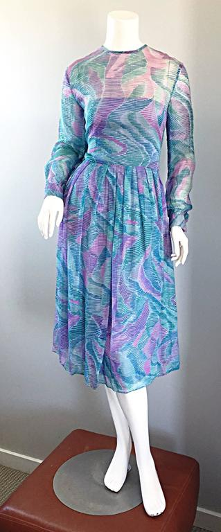 Beautiful late 1970s RICHILENE chiffon dress! Probably the finest and softest chiffon that I have ever felt. Such a pretty watercolor print in purple, pink, and teal! Semi sheer above the bust and sleeves. Wonderful tailored fit is super flattering!