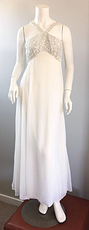 Ethereal vintage EMMA DOMB 1960s white silk chiffon empire waist beaded gown! Words cannot even begin to describe how beautiful this gem is! Would be PERFECT as a wedding dress! Features hand-sewn iridescent sequins and pearls on the front and back
