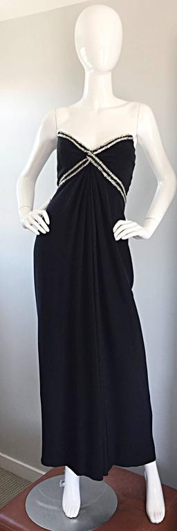 Simply stunning vintage BOB MACKIE for AMEN WARDY black strapless full length silk jersey gown! Features hundreds of hand-sewn rhinestones along the bust and waist. Draping at the waist gives the dress a chic Grecian feel. Super flattering fit, with