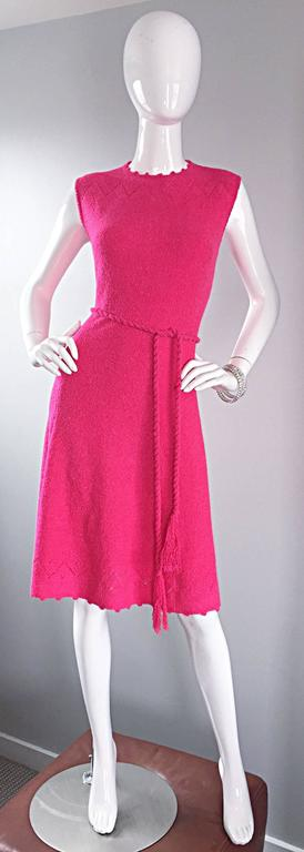 Hands down the most chic vintage 1960s ST. JOHN hot pink / fuchsia knit       A-Line dress! Features crochet detail at neck and at hem. Detachable matching tassel belt. Hidden zipper up the back with hook-and-eye closure. Super soft knit feels so