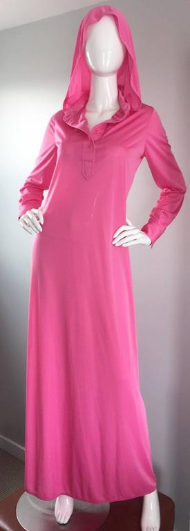 Important and super rare vintage GEOFFREY BEENE hooded hot pink caftan / kaftan! This iconic piece of fashion history has never been worn, and still has the original $3,000 price tag attached from the mid 1970s (equates to $13,671 today). Incredible