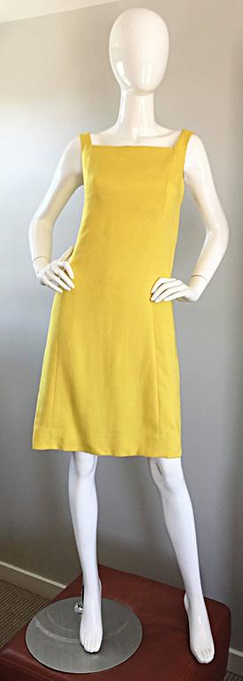 Chic 1960s PAUL STANLEY New York canary yellow linen shift dress! Luxurious Irish linen that is partially lined. Flattering A-Line / Twiggy shape works for a variety of body types. Two buttons at the back sleeves add just the right amount of detail.