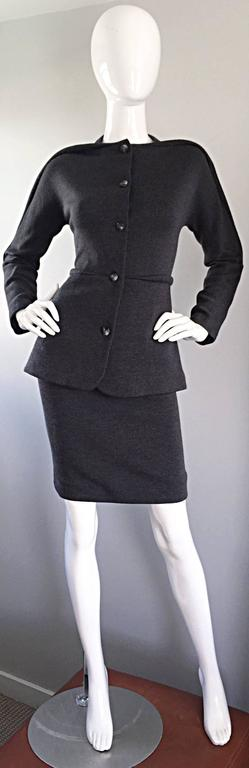 Important vintage 90s GEOFFREY BEENE charcoal grey skirt and jacket suit! Iconic 'piping' along the shoulders of the blazer, and at center waist. Buttons up the bodice. High waisted mini skirt. Hidden zipper up th eback with hook-and-eye closure.