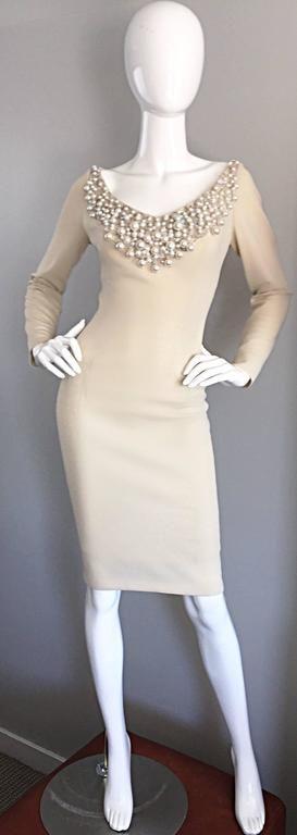 Exceptional vintage 60s SYDNEY NORTH beige crepe jersey wiggle dress! Features hand sewn oversized pearls, sequins and beads at the front bust, acting as a chic collar. Flattering body hugging fit looks fantastic on an array of shapes. Sleek long