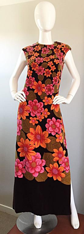 Amazing late 1960s DYNASTY soft velvet maxi dress! Vibrant colors of orange and pink, with a chocolate brown backdrop. Mod flower prints throughout. Extremely well made, with quite a bit of attention to detail in the construction. Luxurious soft