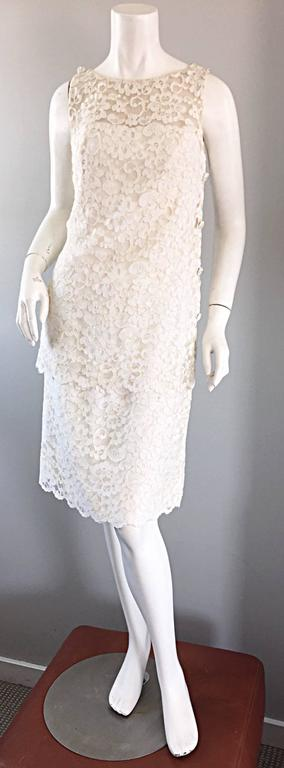 Beautiful 1960s LISA HOWARD white French lace tiered nude illusion dress, with rhinestone buttons! Features two layers of white lace, with a nude illusion backdrop above the bust. White rhinestone encrusted mock buttons up the side, and at each