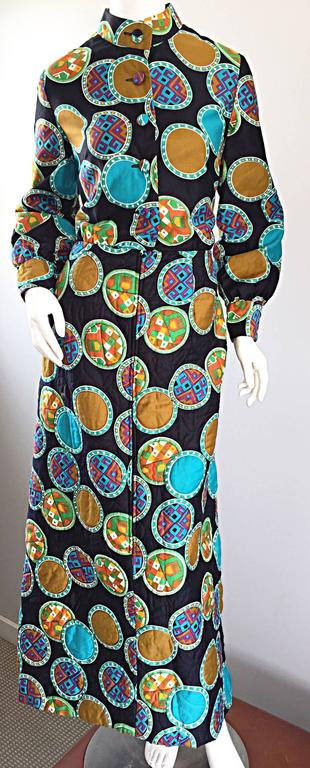 Sensational vintage 1970s DYNASTY for I MAGNIN Chinese inspired colorful cotton maxi dress! Features prints in blues, greens, terra cotta, orange and burnt orange. Fitted bodice, with full sleeves, and a full quilted maxi skirt. Hidden zipper up the