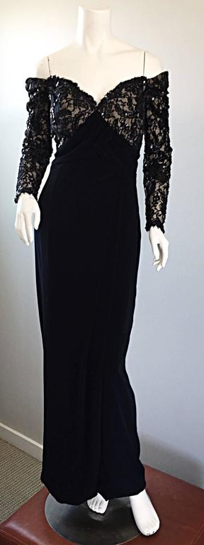 The perfect vintage 90s BOB MACKIE black evening dress! Features a fitted boned lace and hand-sewn sequin bodice, with off-the-shoulder sleeves. Flattering full length skirt, with draping Grecian detail at the side, and at hem. Built in interior