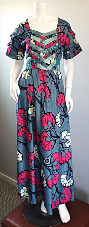 Such a chic 1970s maxi dress! Super soft, yet sturdy cotton fabric, with silk brocade detail at bust, and attached silk brocade belt that ties in the back. Psychedelic themed floral print throughout. Vibrant hot pink mixed with various shades of