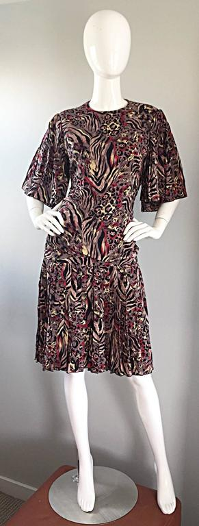 Chic vintage RICHILENE animal print silk drop waist 80s does 20s flapper style dress! Features abstracy asymmetrical prints in zebra, cheetah and leopard. Amazing pleated flutter angel sleeves look phenomenal with movement. Drop waist, with pleated
