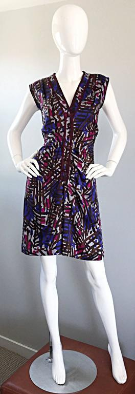 "Amazing vintage YVES SAINT LAURENT ""Rive Gauche"" silk graffiti print sleeveless dress! Features an allover graffiti / Asian themed print. Vibrant hues of purple, burgundy, and blue work brilliantly together! Chic functional maroon buttons up the"