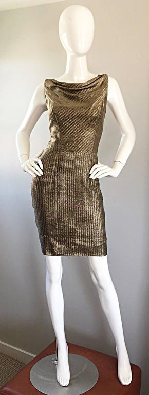 Beautiful and flattering late 1950s vintage silk metallic wiggle dress! Incredible amount of detail was placed on the construction of this gem. Gorgeous golden bronze color. Definitely a high end designer, as there is a Union tag still in place.