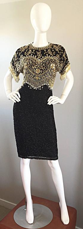 Amazing vintage LILLIE RUBIN black beaded, sequined, and pearled silk cocktail flapper dress! Heavily hand beaded black seed beads throughout the skirt. Gold and silver sequins and beads hand-sewn onto the bodice in a tromp o'lei effect that