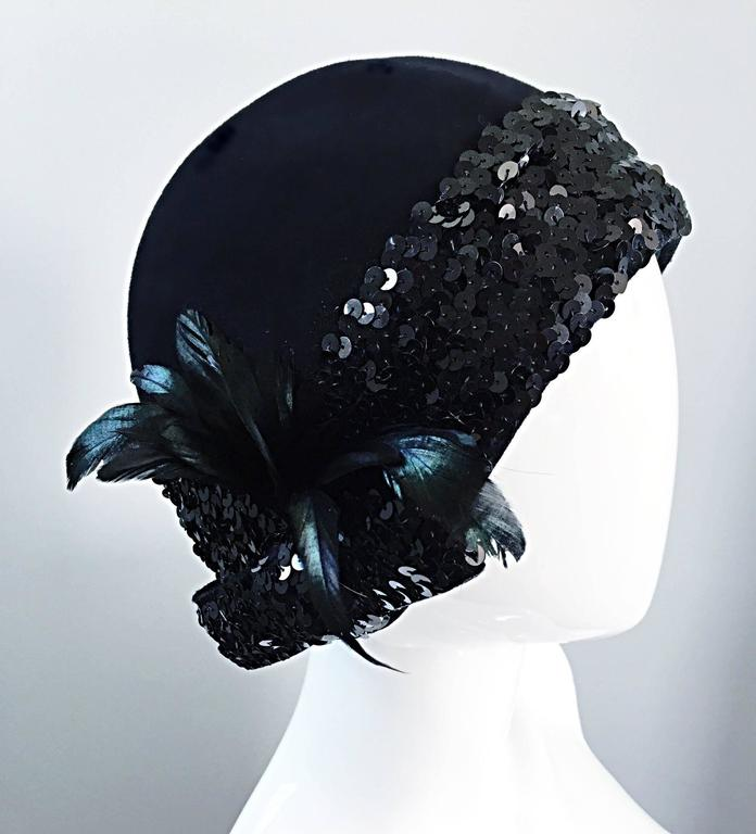 Wonderful vintage 1960s does 1920s ADOLFO black virgin wool cloche hat! So much detail on this rare gem. Features rows of black sequins around the entire trim. Iridescent feathers one one side, with a chic sequin bow under. Great with jeans, yet