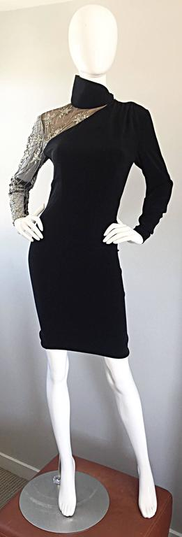 Sexy vintage BOB MACKIE black Avant Garde bodycon dress! Tailored body hugging fit, with one nude illusion sleeve that features silver hand-sewn sequins in the shape of shooting stars. Tailored long black sleeve with hidden zipper. Asymmetrical