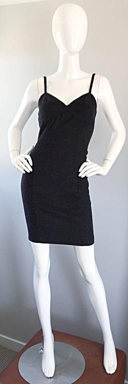 Sexy yet sophisticated vintage MICHAEL KORS early 1990s charcoal gray sleeveless bodcon dress! The perfect alternative to the little black dress! This flattering number really flatters the body, and hugs the curves in all the right places, which