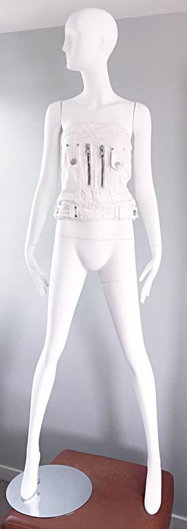 Sexy DSQUARED2 white denim strapless bustier/corset style top! Features stark white denim, with silver accents throughout. Two large silver zippers on the front bodice, and a full silver metal zipper up the back. Two silver buttons at each side of