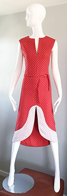 Amazing and super rare vintage 60s PIERRE CARDIN Couture red and white mod dress with sash belt! Heavy duty soft double cotton keeps shape nice, while flattering the body. Tiny polka dot print throughout. Chic Avant Garde cut-out at center hem