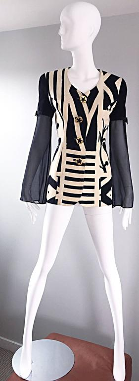 Amazing vintage 90s GEMMA KAHNG black and white Avant Garde blazer jacket! Wonderful tailored fit with impressive abstract prints. Oversized decorative gold buttons up the bodice. Semi sheer black silk chiffon angel sleeves, adorned with a chic