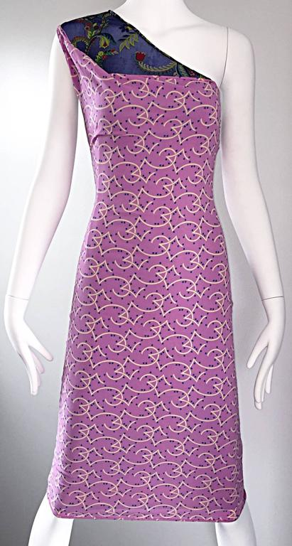 Amazing vintage 90s GIANNI VERSACE COUTURE (Pre Death) one shoulder bodcon dress! Features a purple silk/rayon jersey overlay, with mini stars printed throughout. Underneath is a vibrant royal blue tropical printed semi sheer silk attached toga