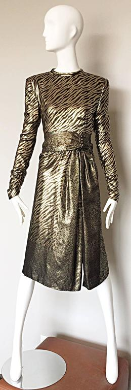 Amazing vintage 1970s / 70s PAULINE TRIGERE gold and black silk lame animal print long sleeve dress! Form fitting bodice with sleek tailored long sleeves. Chic gathers at sleeve cuffs with hidden zippers. Attached belt at waist with hidden zippers