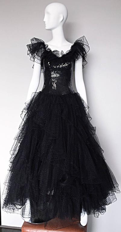 Stunning vintage 1980s DAVID FIELDEN black silk and tulle sequin Avant Garde evening dress! Features layers and layers of black embroidered tulle on the skirt, with dramatic matching sleeves. Form fitting black sequined boned bodice, with an