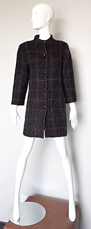 Chic 1970s GEOFFREY BEENE (Beene Bag) grey and red plaid Swing Jacket! Chic wool and mohair blend with an oversized plaid print throughout. Black lacquer buttons up the front. Pockets at each side of the waist. Fully lined. The perfect everyday