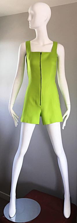Extraordinary and super rare chic vintage CLAUDE MONTANA early 1990s / 90s one piece romper / playsuit / jumpsuit! Electric neon lime green color on a soft cotton and linen blend. Full metal zipper up the front bodice. Super flattering fit that