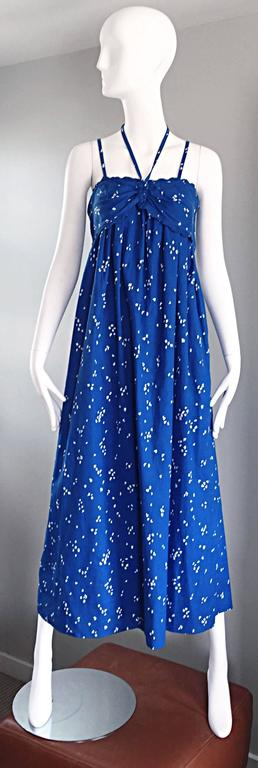 Beautiful vintage 1970s BILL TICE for I. MAGNIN royal blue and white hand painted cotton maxi dress! Features an allover hand painted white 'splatter' print throughout. Two spaghetti straps at each shoulder, and an adjustable halter strap that ties