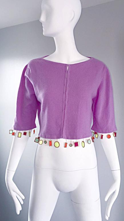 Whimsical MATTHEW WILLIAMSON lilac light purple cashmere cardigan sweater! Luxurious Scotish cashmere feels amazing against the skin! Neon appliqués along the front and back hem, and at the sleeve cuffs. Hook-and-eye closure up the bodice. The