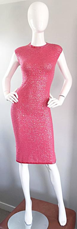 Sexy 1950s hot pink knit crochet wiggle dress! Features thousands of hand-sewn sequins throughout on a soft hand crochet hot pink knit. Body hugging fit drapes over the curves brilliantly! Stretches to fit, and looks like Gene's Shelley! Very well