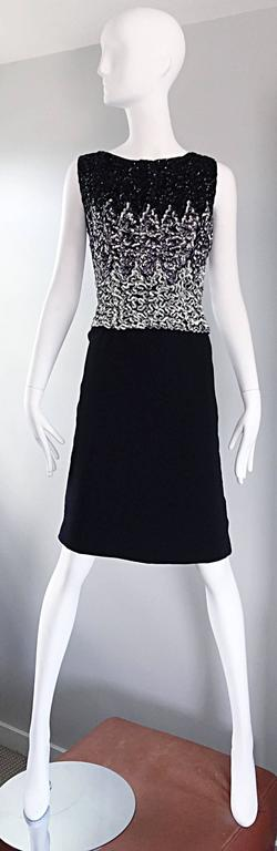 Sensational late 1950s black, silver and gunmetal sequined wiggle shift dress! Features allover hand-sewn sequins throughout the front and back of the bodice. Peek-a-boo at the top back with button closure. Great fit, and easy to wear. A timeless