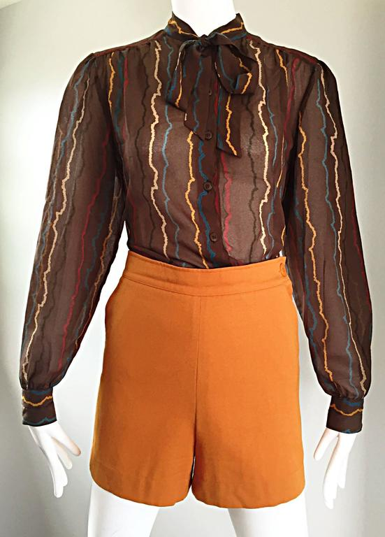 Chic vintage 1980s MONDI semi sheer silk taupe Pussycat bow blouse! Features sgwiggles of color throughout in yellow, red, blue, taupe and black throughout. Buttons up the bodice, with a self-tying bow at neck. Buttons at each sleeve cuff. Great