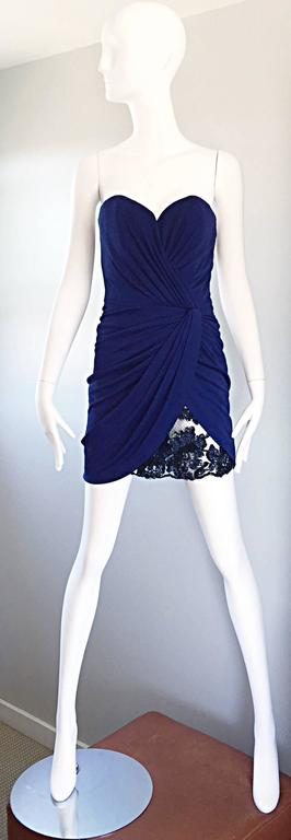 Sexy vintage VIKY TIEL COUTURE 1990s / 90s navy blue ruched strapless mini jersey dress! Features flattering ruching throughout the front. Navy blue French Chantilly lace and sequined peek-a-boo at left hem. Sweetheart bust looks amazing on! Amazing