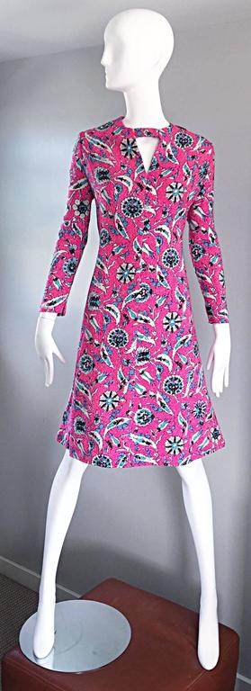 Beautiful vintage 60s ADELE SIMPSON for I. MAGNIN hot pink fuchsia, blue, silver and black lurex knit metallic dress! Perfect A-Line fit that is so chic and flattering. Cut-out above bust adds reveals just the right amount of skin. Long sleeves make