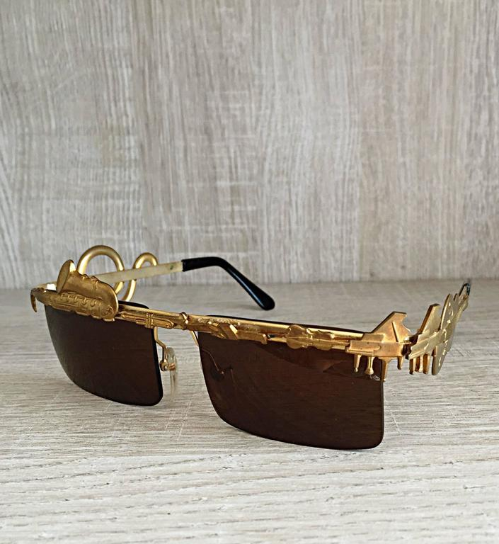 Rare, and absolutely amazing vintage MERCURA unisex sunglasses! These glasses feature an amazing amount of detail. Mercura was known for their unique designs, and superb quality! They are so hard to find, and this is my first pair to ever own!