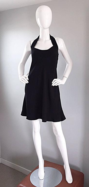 Incredible, rare and super iconic vintage 1990s MOSCHINO CHEAP & CHIC little black dress, with chic peace sign cut-out at the back! Flirty Babydoll fit that flatters many shapes and sizes. Cut-out peace sign with silk satin trim that extends around