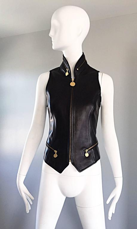 Sexy vintage DONNA KARAN Black Label Lambskin black leather vest! Incredibly flattering tailored piece by this iconic designer. Features gold zipper up the bodice, two gold zippers at the front pockets, and a gold zippered pocket along the collar.