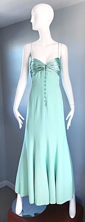 Beautiful vintage VALENTINO light green gown! Flattering and flirty fit. Silk covered buttons up the bodice, with a zipper under. Thin silk spaghetti straps criss-cross in the back. Fully lined. Looks amazing on, and is perfect for any day or